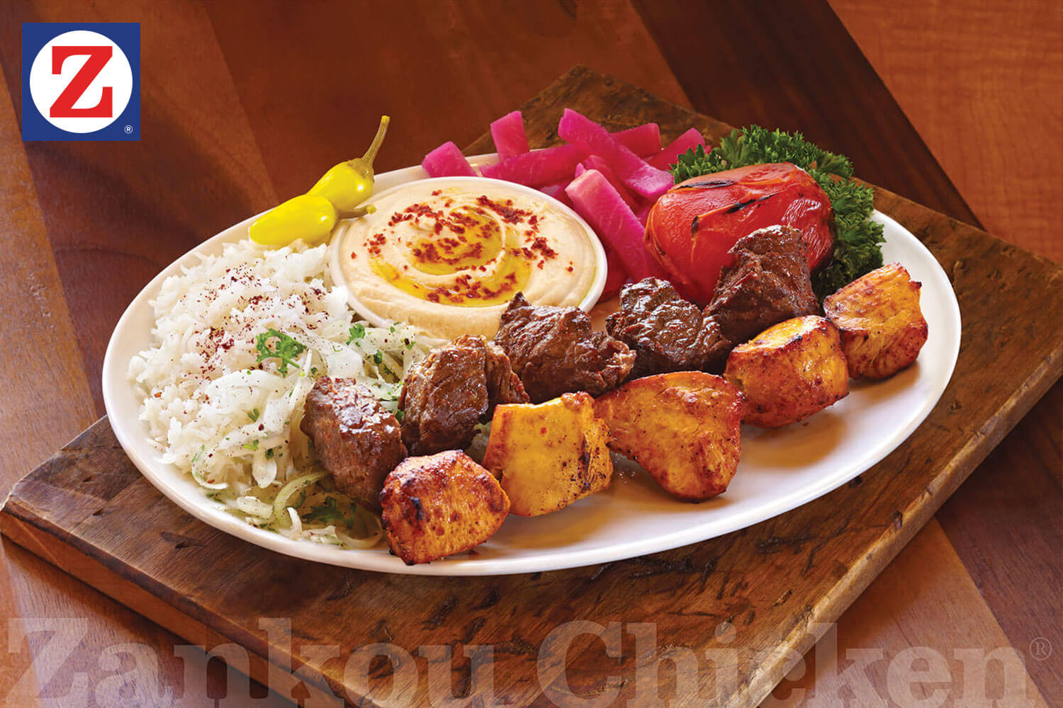 Combo steak and chicken kabob plate with sides