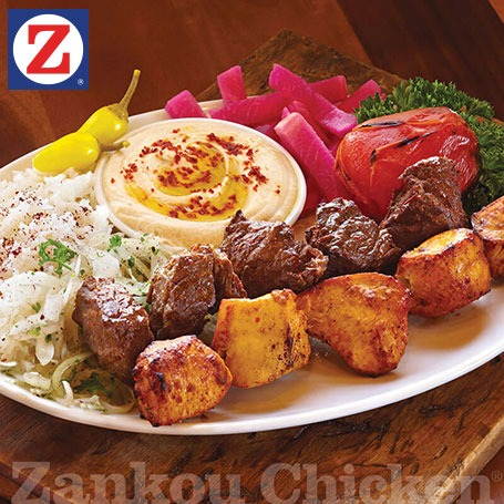 Combo kabob plate with 1 steak and 1 chicken skewer and sides