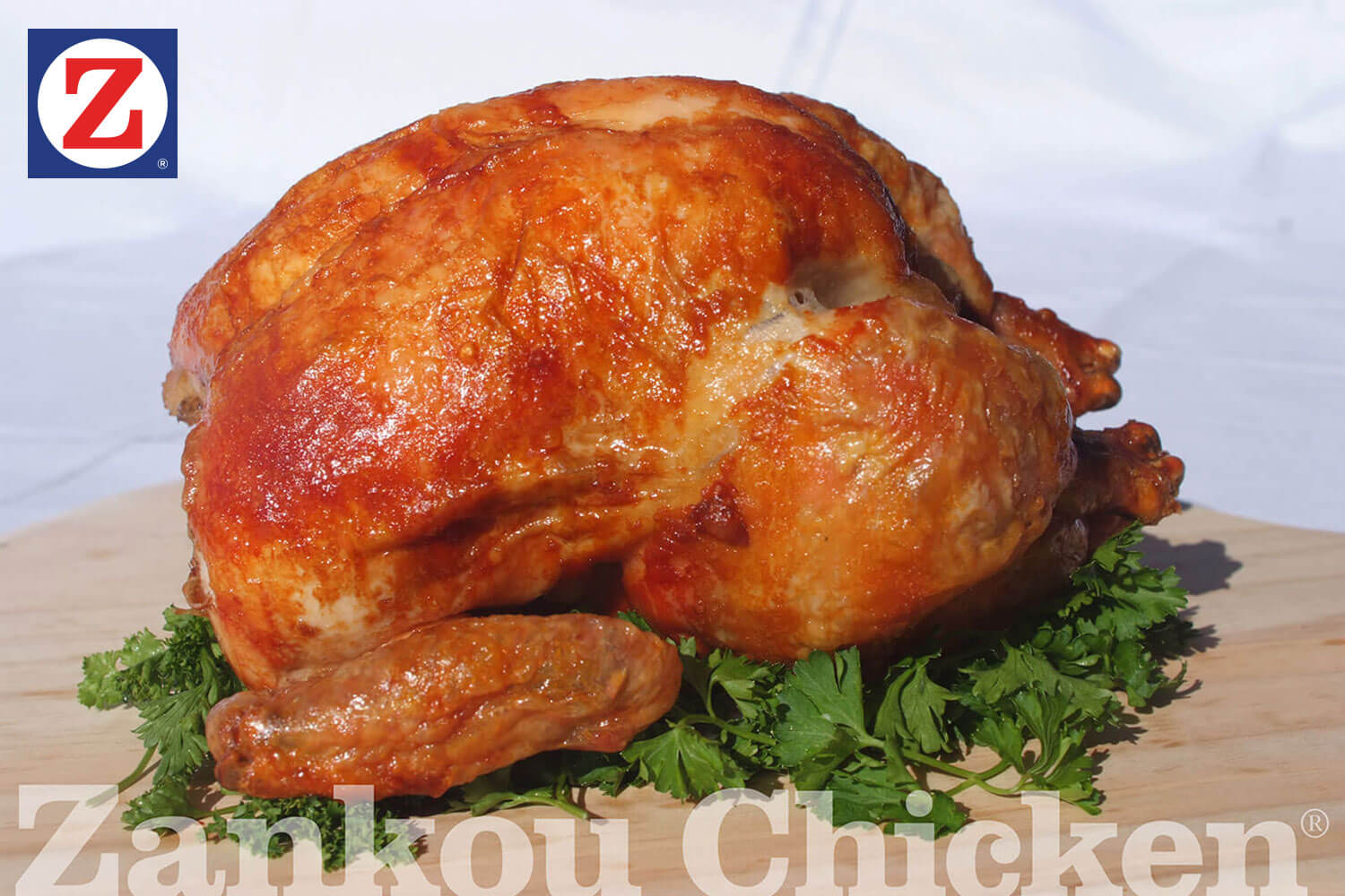 Zankou Chicken's famous whole roasted chicken on a bed of parsley