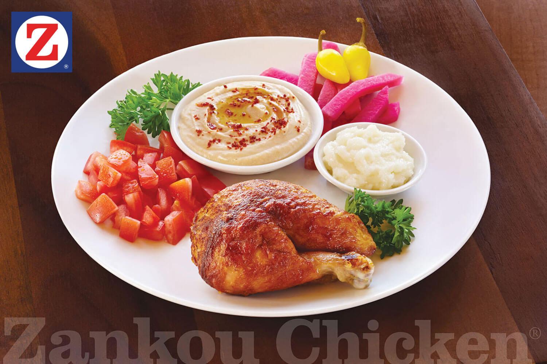 Plate of quarter dark chicken with sides