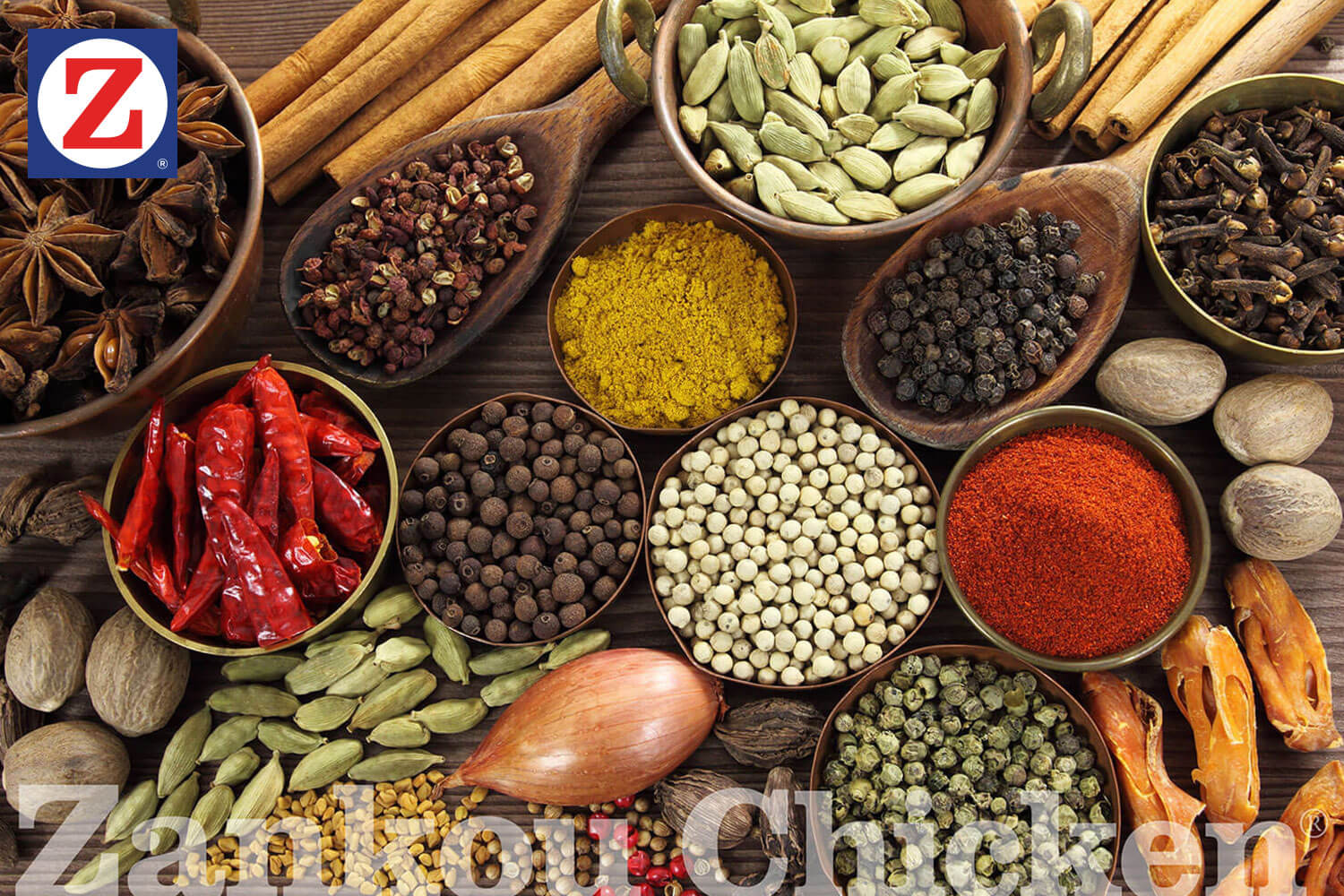 Looking down on a table full of spices in wooden bowls